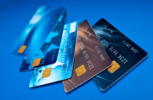 collection of credit card on blue surface